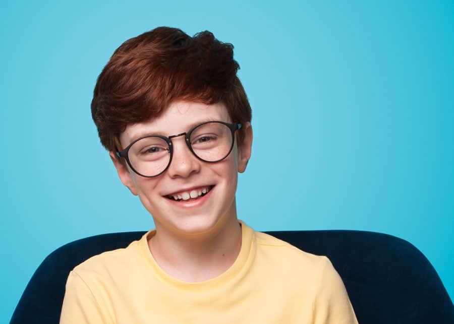 Ginger Boy Sitting Armchair Wearing Eyeglasses